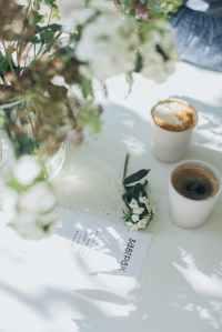 photo of coffee near flower vase